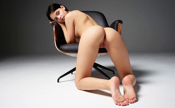 Ariel Perky Naked Brunette in a Chair