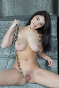 Busty Evita Lima Posing with a Chain