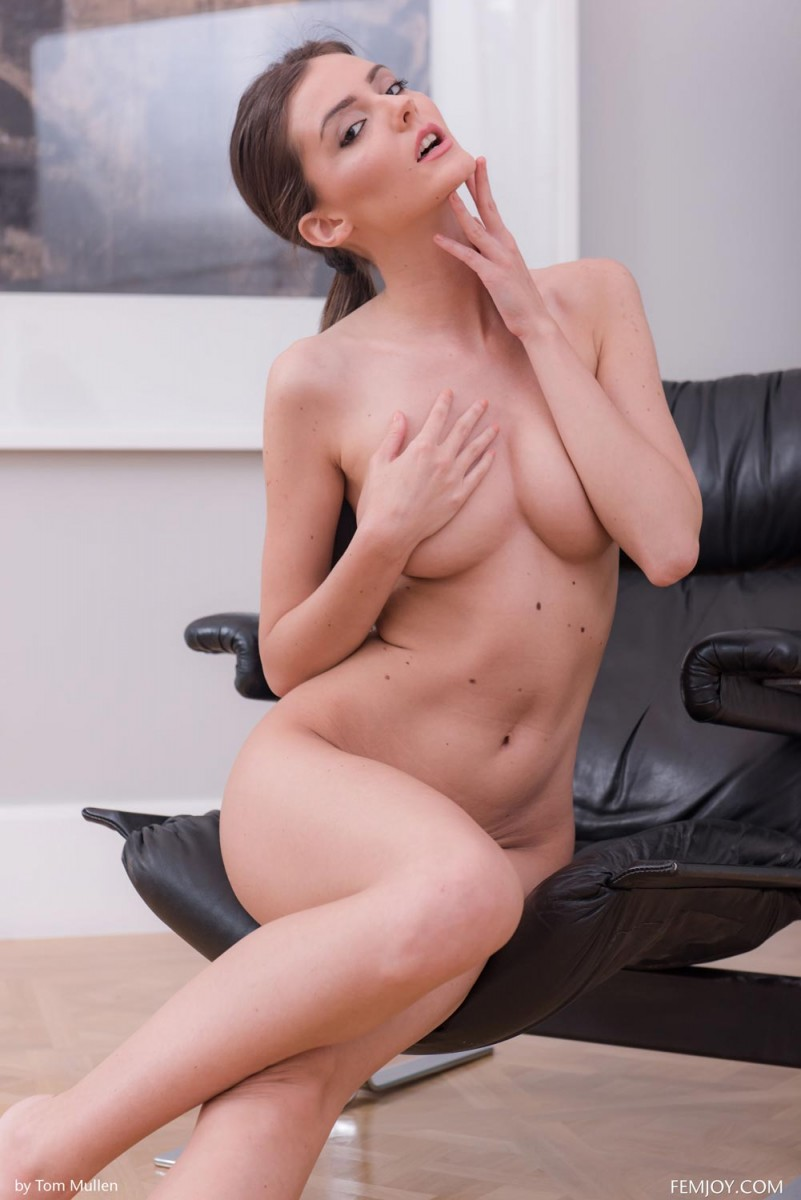 Leggy Rene Star in a Leather Chair